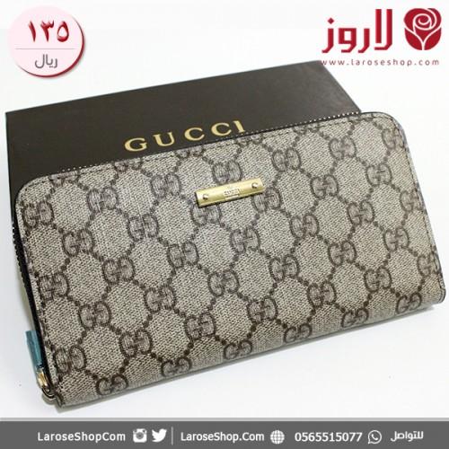 محفظة قوتشي Gucci لأنثي جذابة